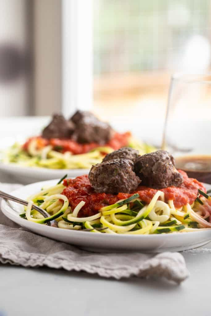 Whole30 Meatballs on top of 2 plates of noodles