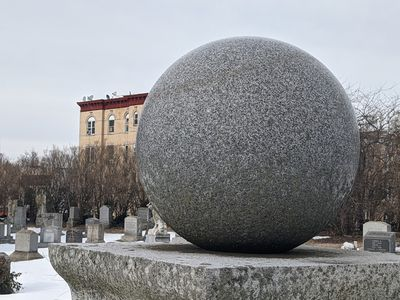 A close-up of the granite baseball topper