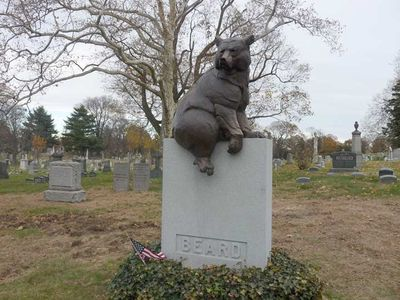 The gravesite for William Holbrook Beard, adorned by a bronze bear sculpture