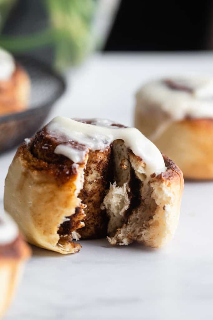 one Air Fryer Cinnamon Roll with a bite taken out
