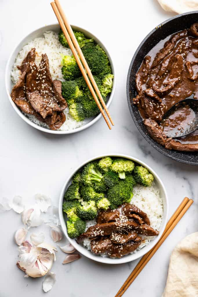 two bowls of Beef with Garlic Sauce with chopsticks