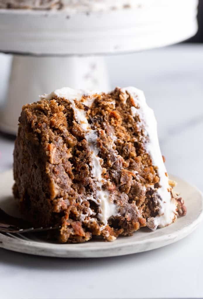 a slice of Vegan Carrot Cake on a small plate