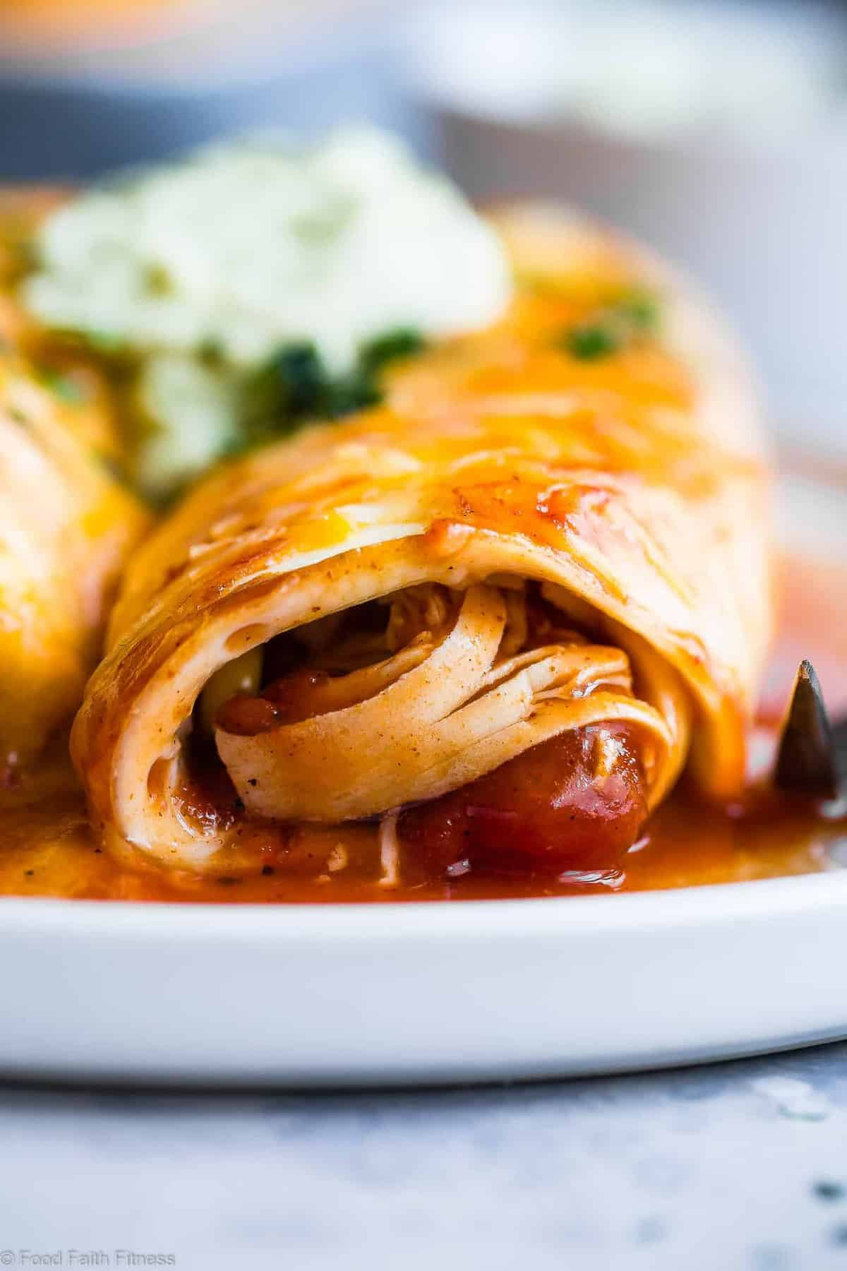 Healthy Low Carb Chicken Enchiladas -This gluten free Healthy Low Carb Chicken Enchilada Recipe uses a secret ingredient to make it low carb, proteinPACKED and under 500 calories for a HUGE serving! These do NOT taste healthy and even picky eaters love them! | #Foodfaithfitness | #Lowcarb #Glutenfree #Healthy #Grainfree #Enchiladas