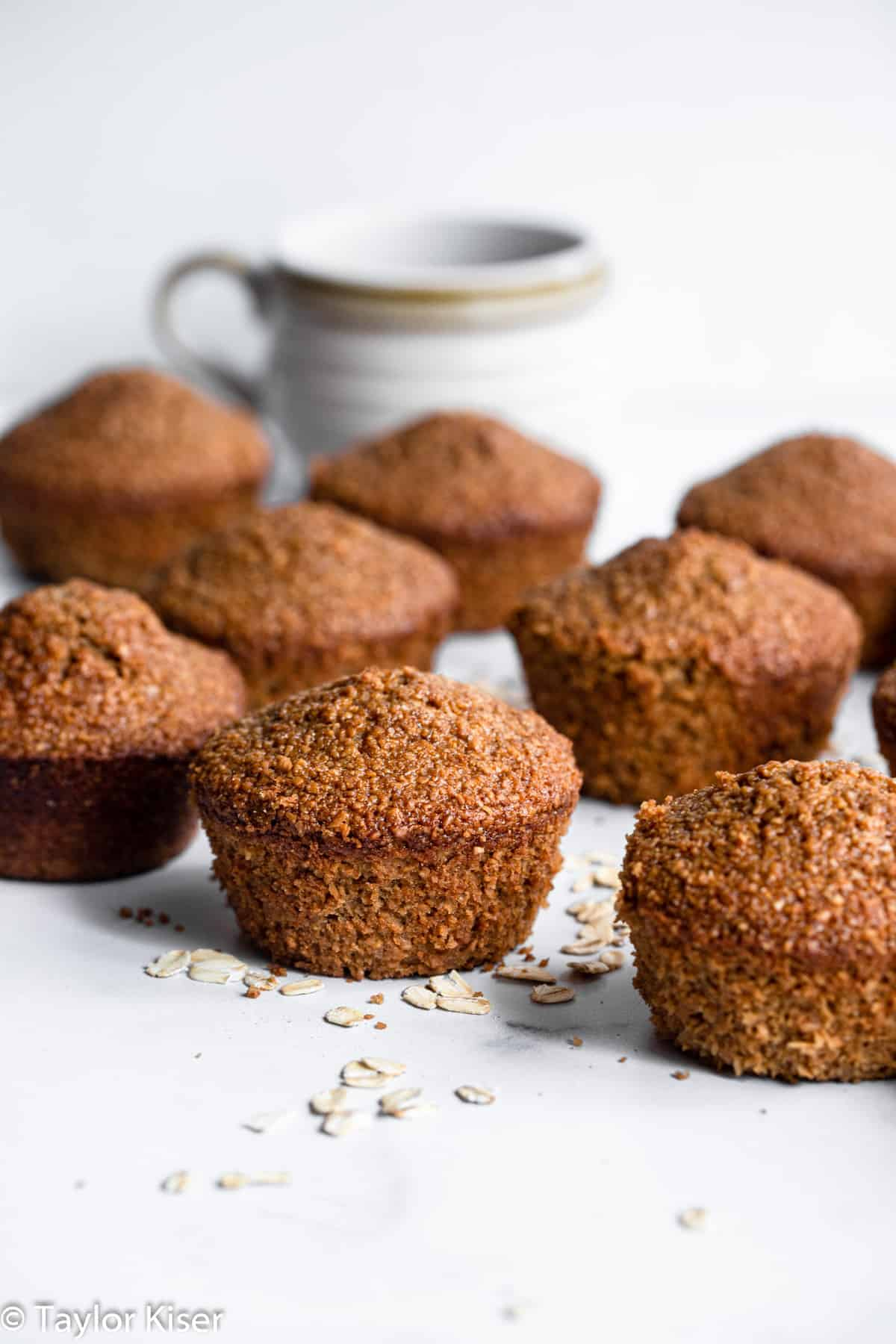 healthy oat bran muffins sitting on a table with coffee