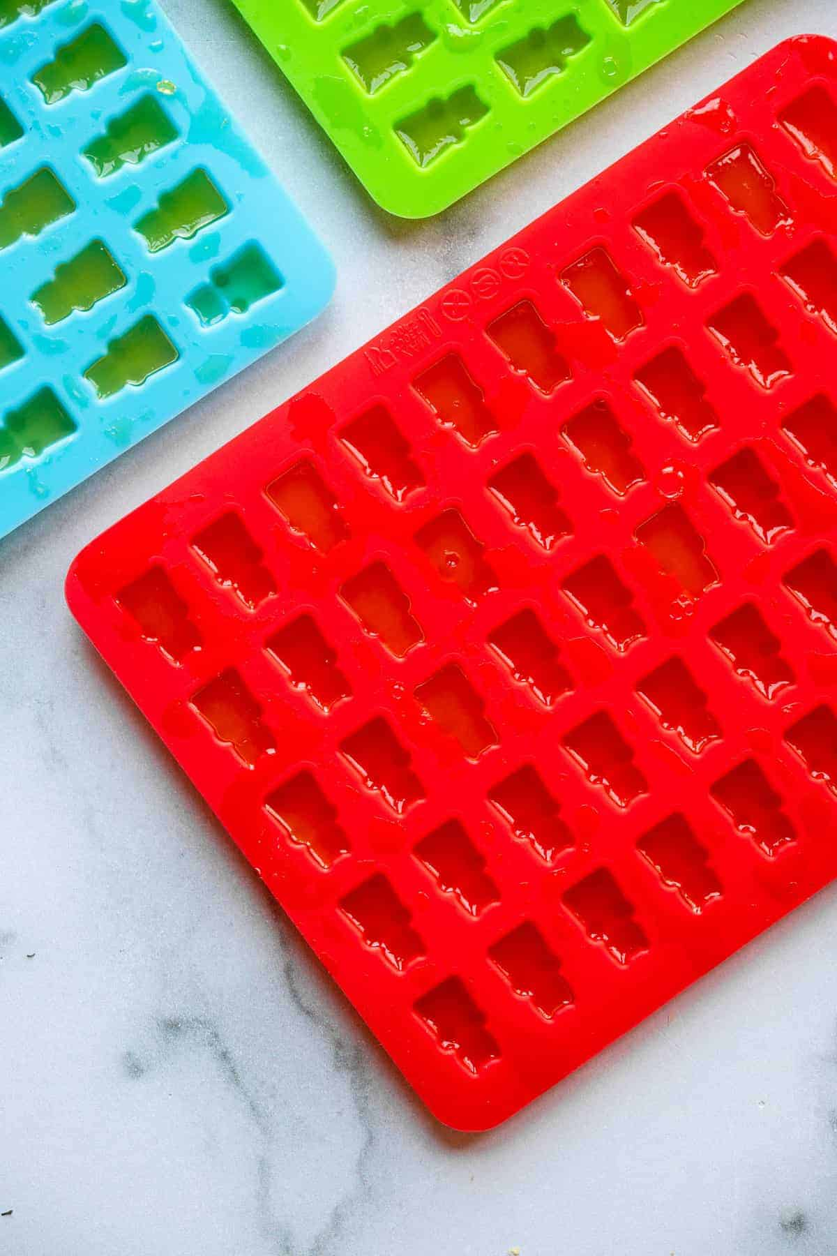 gummy bear mold being filled with healthy gummies