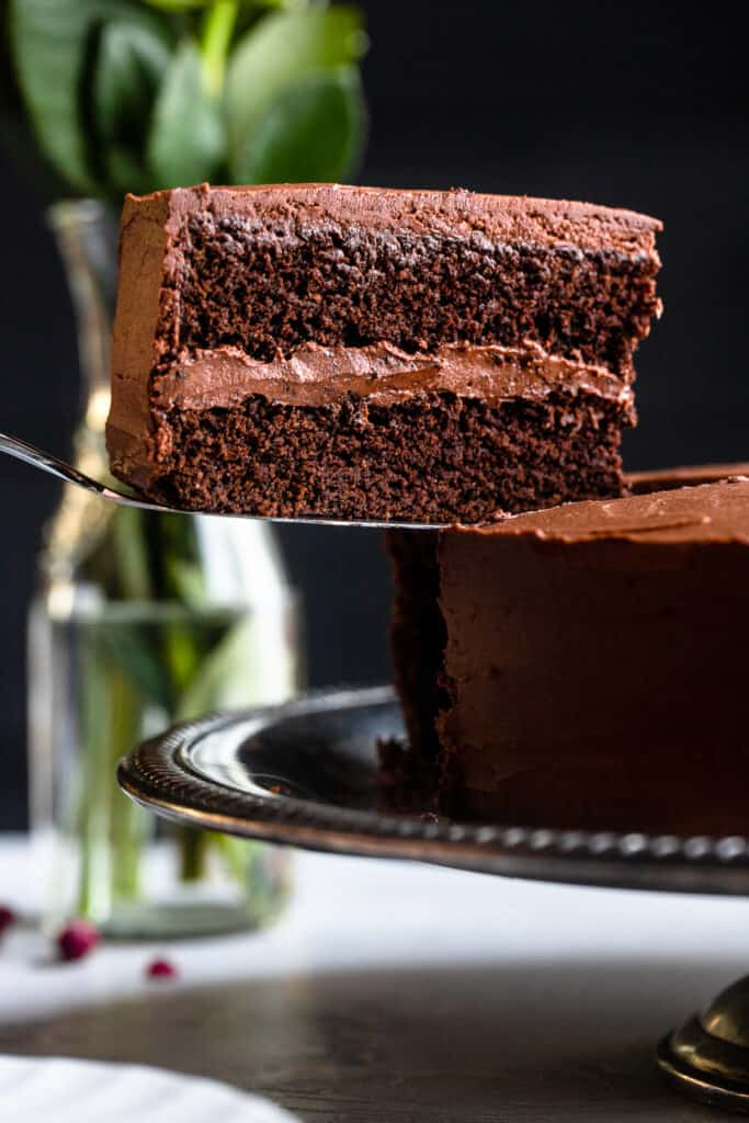 one slice of Keto Chocolate Cake being lifted by a cake server