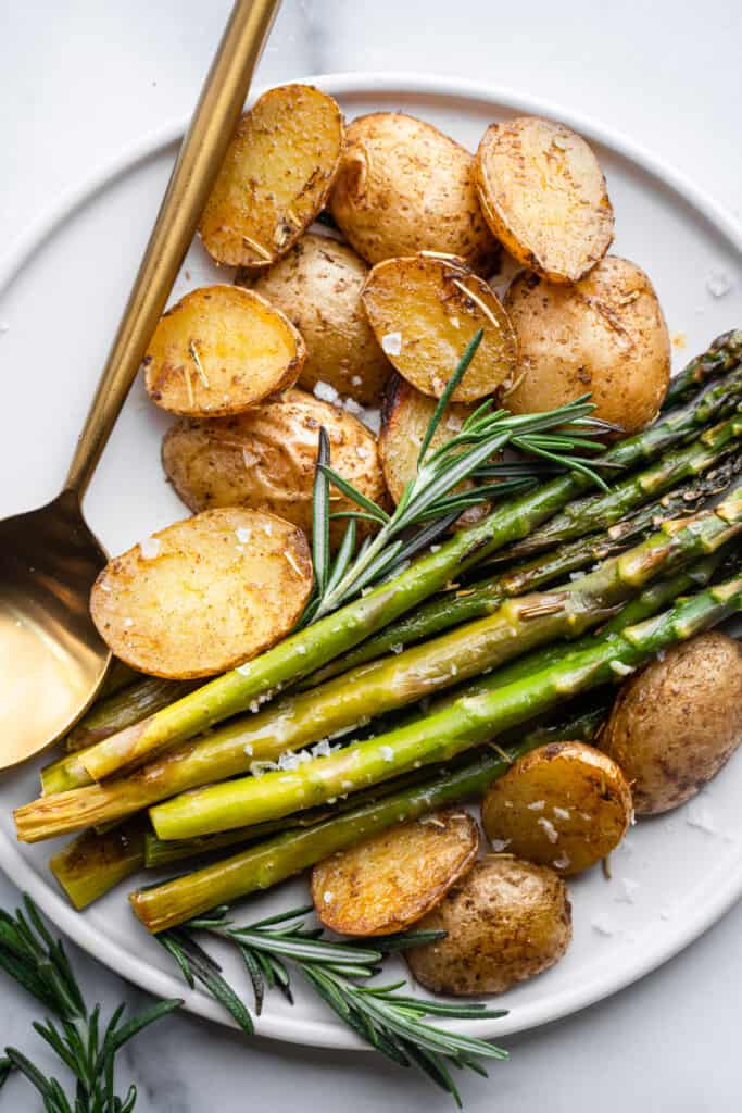 close up view of Roasted Potatoes and Asparagus on a plate