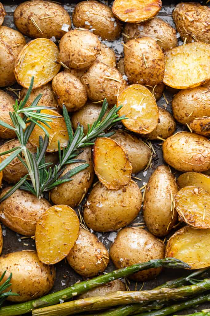 Roasted Potatoes and Asparagus on a baking sheet