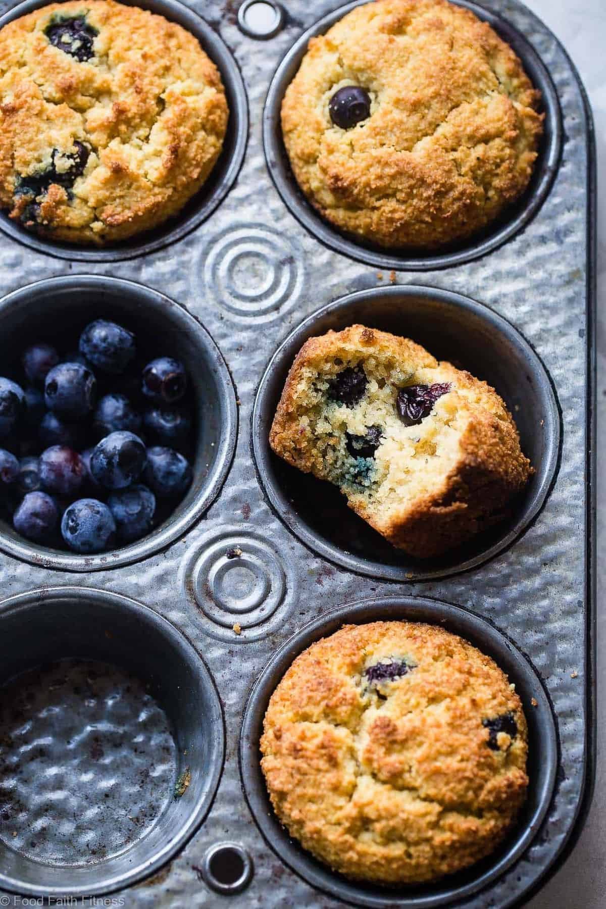 Keto Muffins arranged in a muffin tin with blueberries