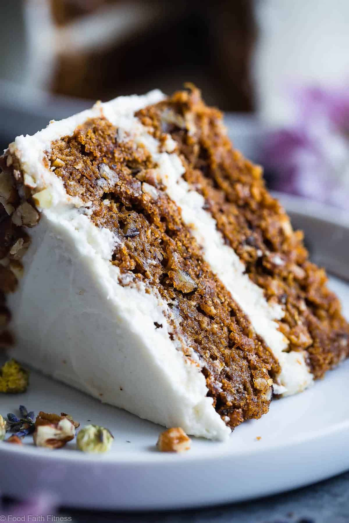 The BEST Gluten Free Vegan Carrot Cake - This one bowl, healthy carrot cake is SO moist and tender, you'll never know it's plant based, made without eggs and is gluten/grain/dairy/refined sugar free! Perfect for Easter! | #Foodfaitfitness | #Vegan #Easter #Glutenfree #DairyFree #Carrotcake