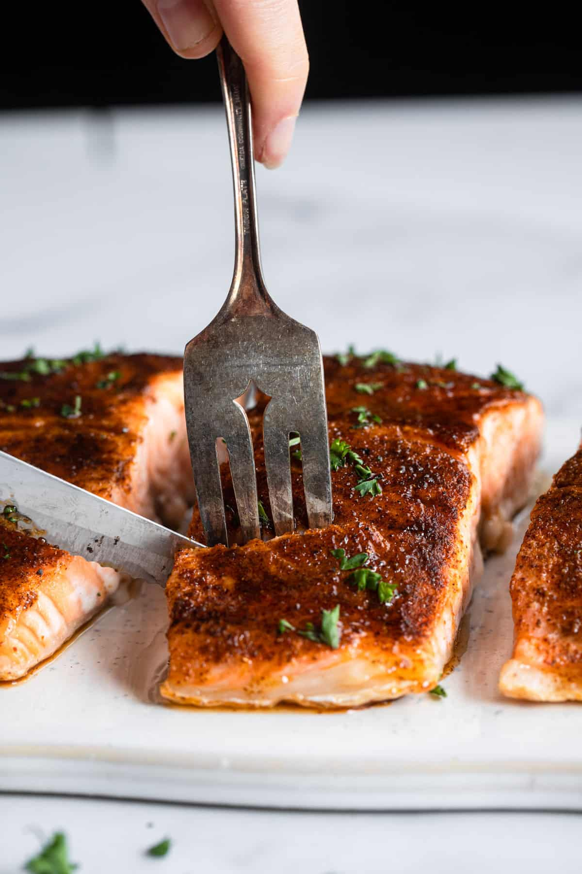 Honey Cajun Salmon being cut into with knife and fork