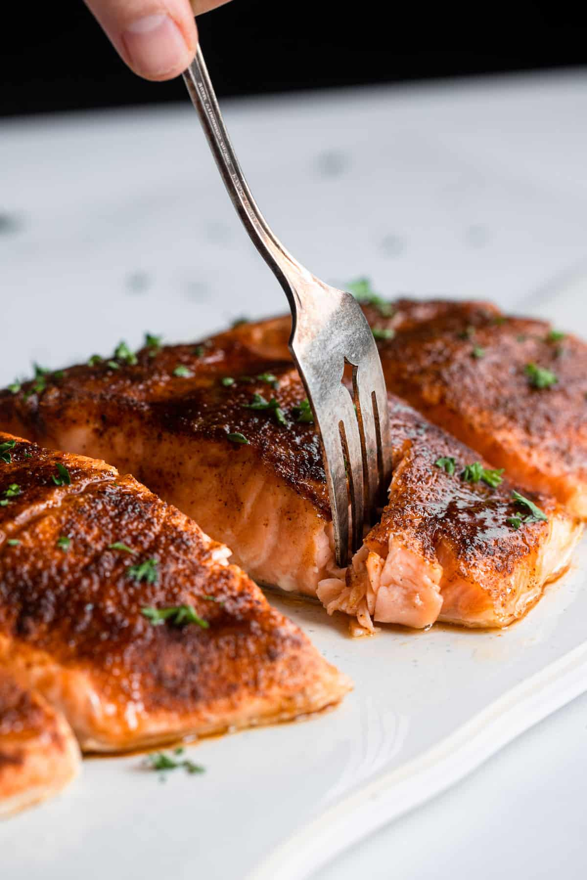 Honey Cajun Salmon being cut into with a fork