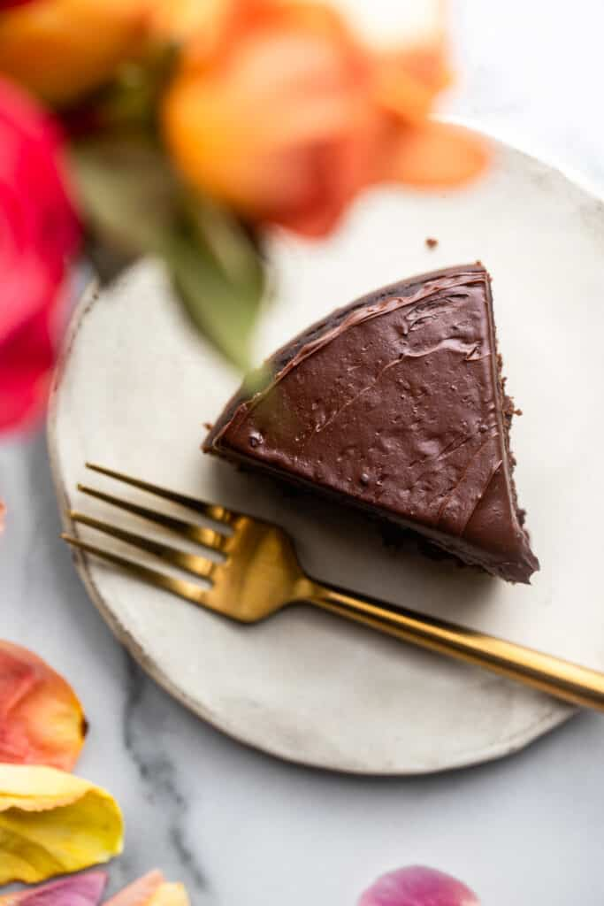 one slice of Instant Pot Chocolate Cake on a plate with a fork