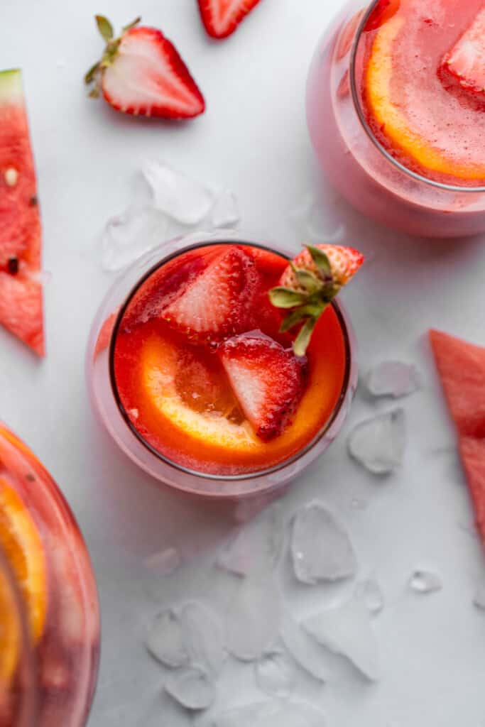 a glass of Watermelon Sangria with a strawberry garnish