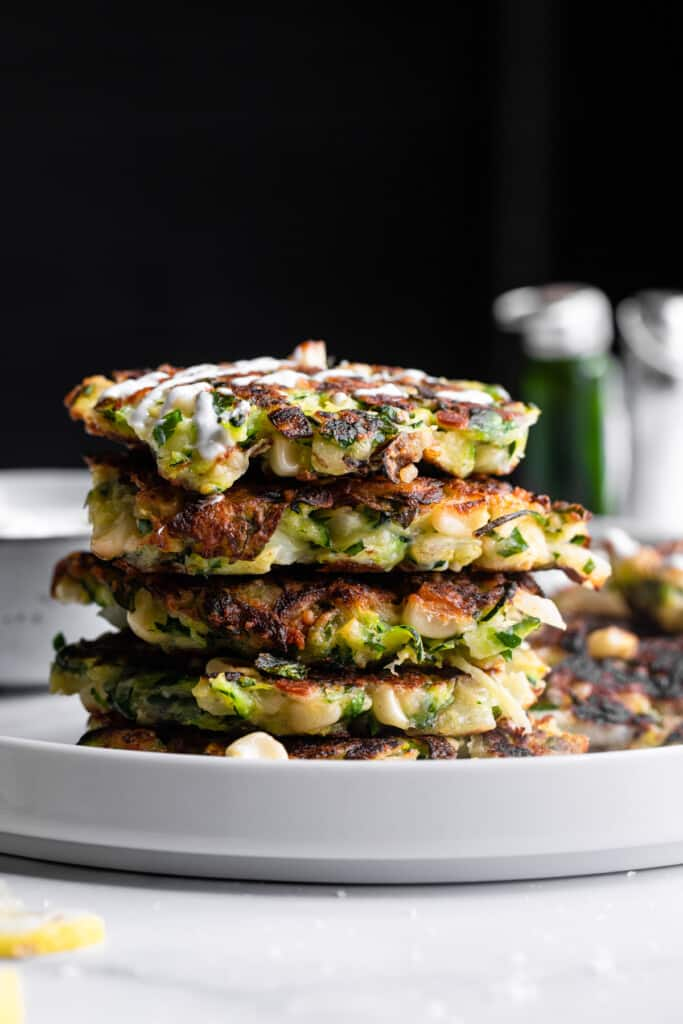 a stack of Zucchini Corn Fritters on a plate