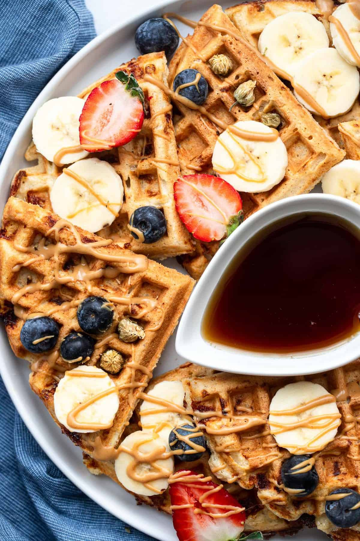 protein powder waffles with strawberries on top