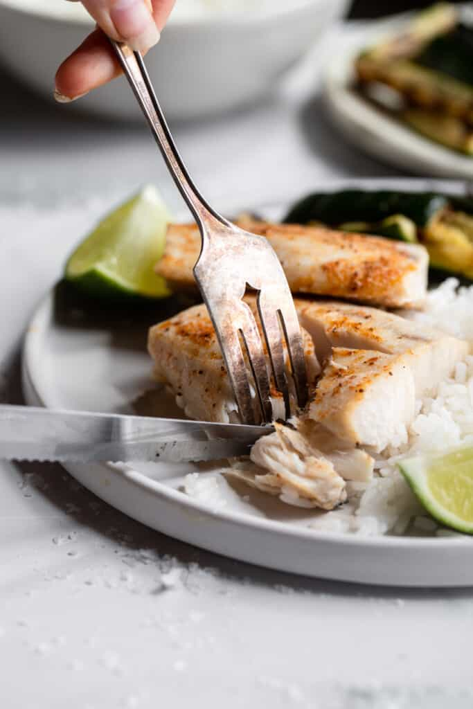 a fillet of Air Fryer Mahi Mahi on a plate with fork and knife