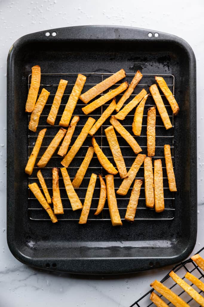 a baking dish full of Keto French Fries