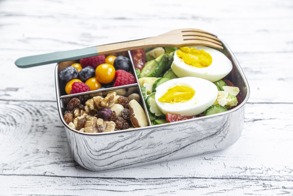 healthy lunch box with trail mix and berries royalty free image 1624909151