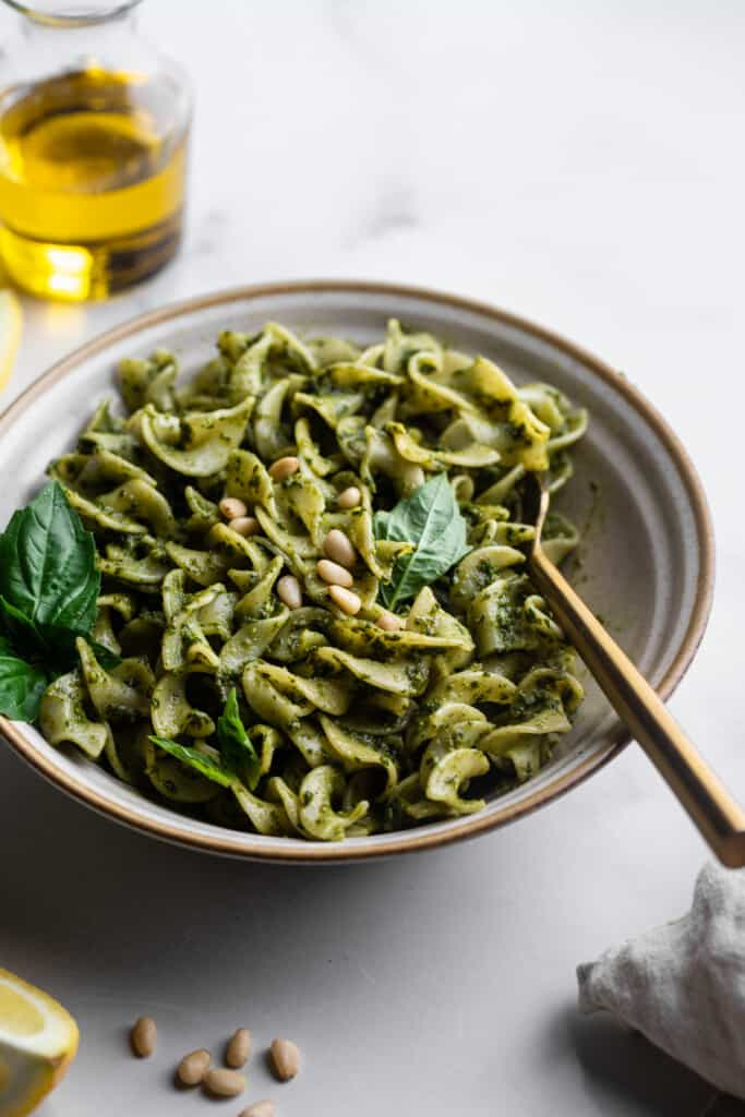 a bowl of pasts with Dairy Free Pesto on it