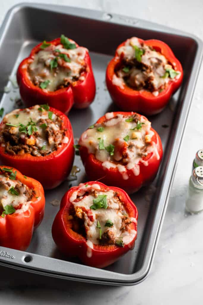 a baking dish fully of cooked Keto Stuffed Peppers